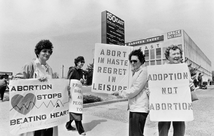 Anti-Abortion Campaigners stage a counter-demonstration during a Pro-Choice march on New York State Route 27 during Reproductive Freedom Week, New York, May 1988. May 01, 1988. Photo by Barbara Alper. Courtesy of Getty Images.