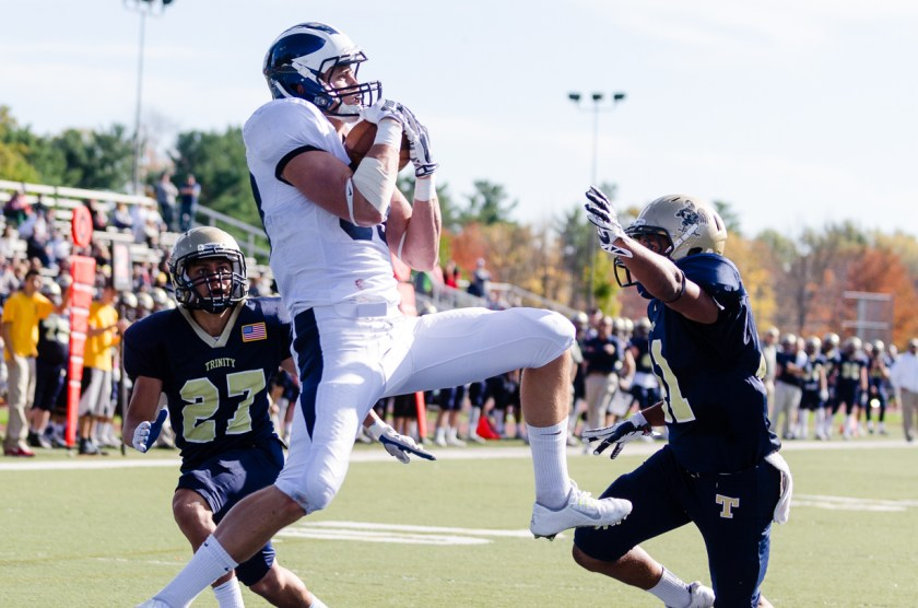 Matt Minno '16 hauls down one of his three touchdowns in the Panthers' victory. Courtesy of Greg Sullivan (http://www.sevenstrong.net/TrinityFootball)