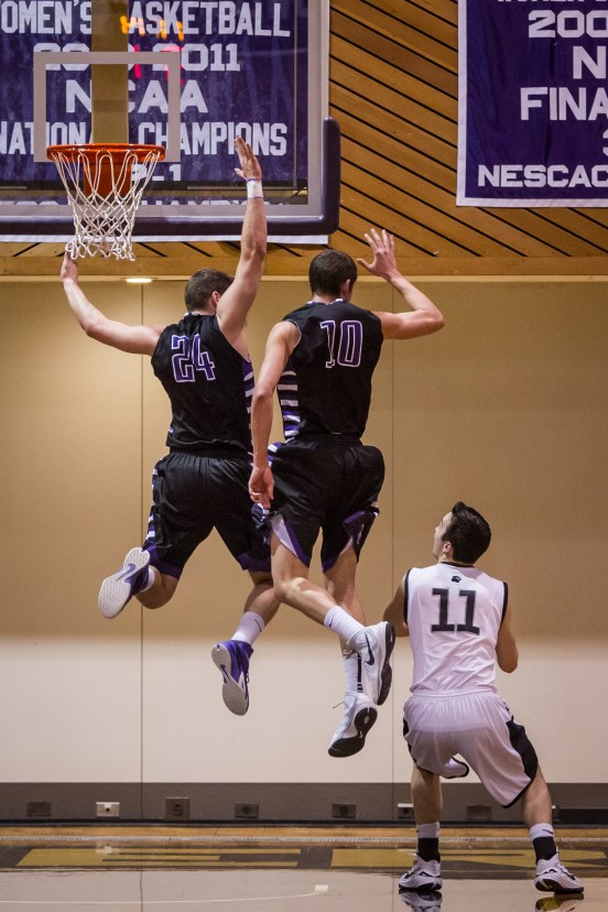 Jake Donnelly '16 gets Connor Green '16 and Johnny McCarthy '18 in the air. (Courtesy of Amherst Athletics)