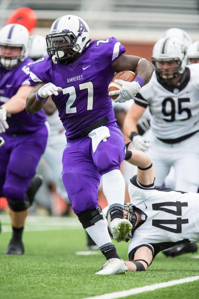 RB Kenny Adinkra '16 never goes down from the first hit. (Courtesy of Amherst Athletics)