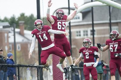 QB Pat Dugan '16 OL Sean Lovett '18 after something good happened. Clearly. (Courtesy of Josh Kuckens/Bates College)