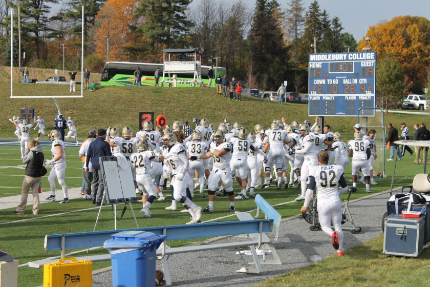 The Trinity bench goes wild as Archi Jerome '17 returns an interception for a game-winning score against Middlebury. (Photo by Joe MacDonald)