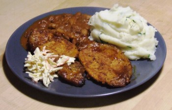BBQ pork chops served with coleslaw, blazin saddles baked beans and mashed spud