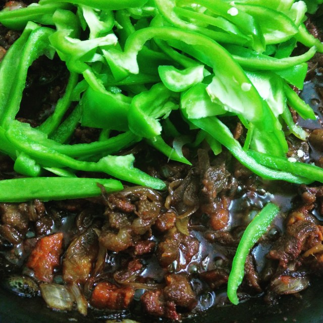 Cook sliced green capsicum with Goan Pork Sausage
