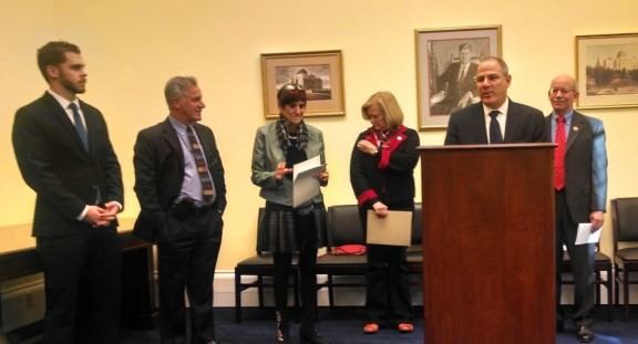 Lawmakers and organization leaders speak at a press conference about GMO labeling in DC January 16, 2014