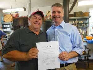 Wayne Burch, owner of Crazy Clover Butcher shop, and Rob Wittman holding the PRIME Act, HR 3187