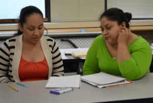 Moms study English at the North Godwin English literacy class