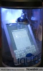 iPad under stream of water