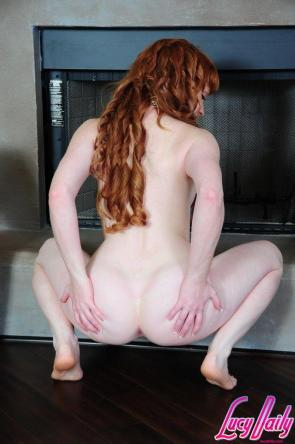 Lucy O'Hara squating to spread her ass