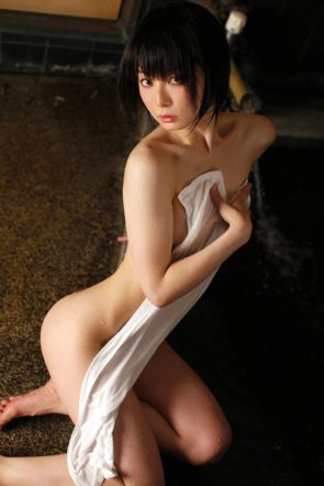 asian hiding her tits with a towel