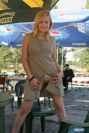 flashing her shaved pussy at a fair