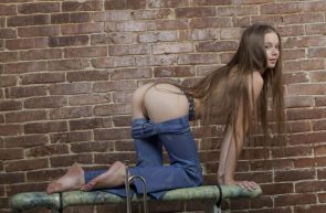 long hair at the brick wall