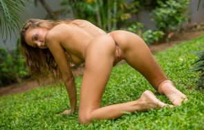 naked in the green grass