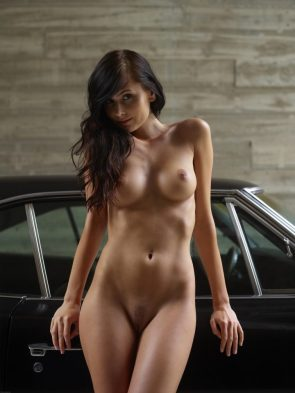 nude woman by classic car
