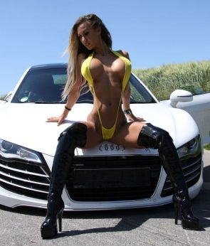 rubbing her asshole on a white car