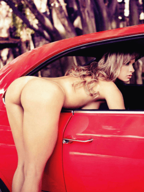 nude woman leaning into red car