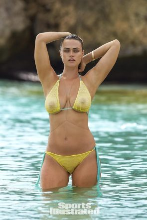 Myla Dalbesio arms up in yellow