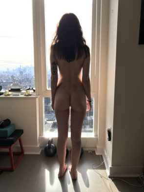 a nice firm butt by a high rise window
