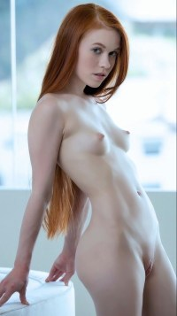 Dolly Little is a cute red head