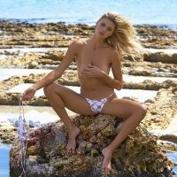 Kelly Rohrbach topless on the rocks