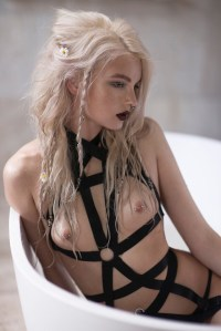 blonde with straps and piercings