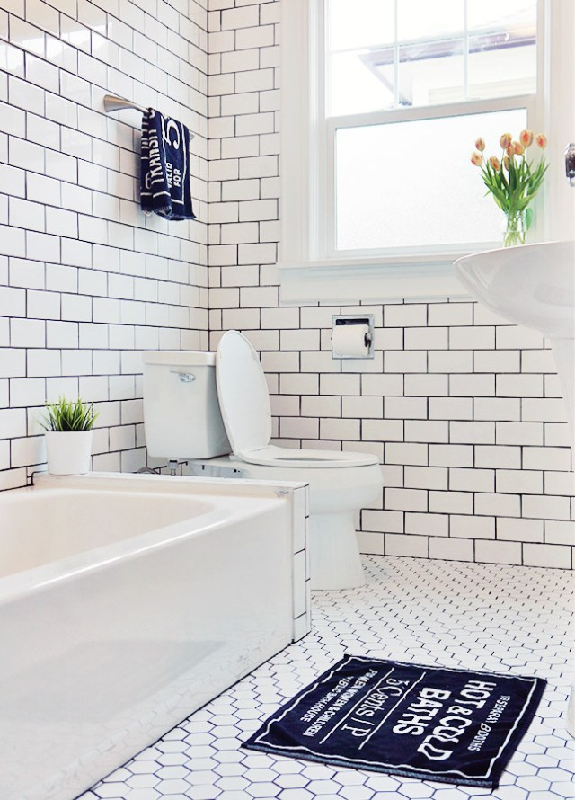 Nubby Twiglet | Bathroom Remodel with Subway Tile and Black Grout