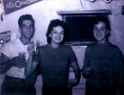 This is a photo I took myself about 60 years ago circa 1956. Jimmy is standing with two of the girls in our crowd Diane Schleininger and Janet Gartner.