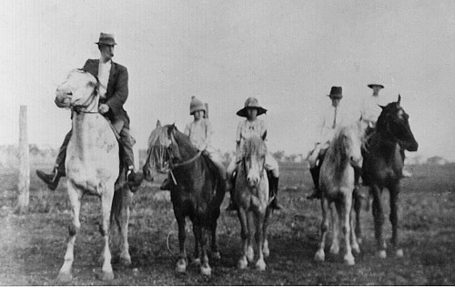 E. On horses (Caption 'In 1922')