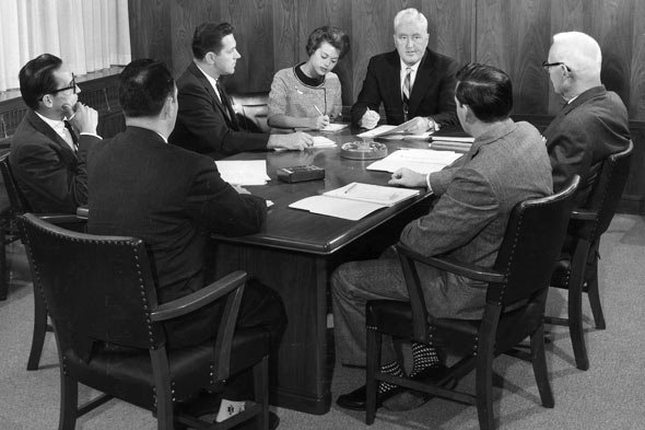 woman-boardroom-men-working-590sd05212010
