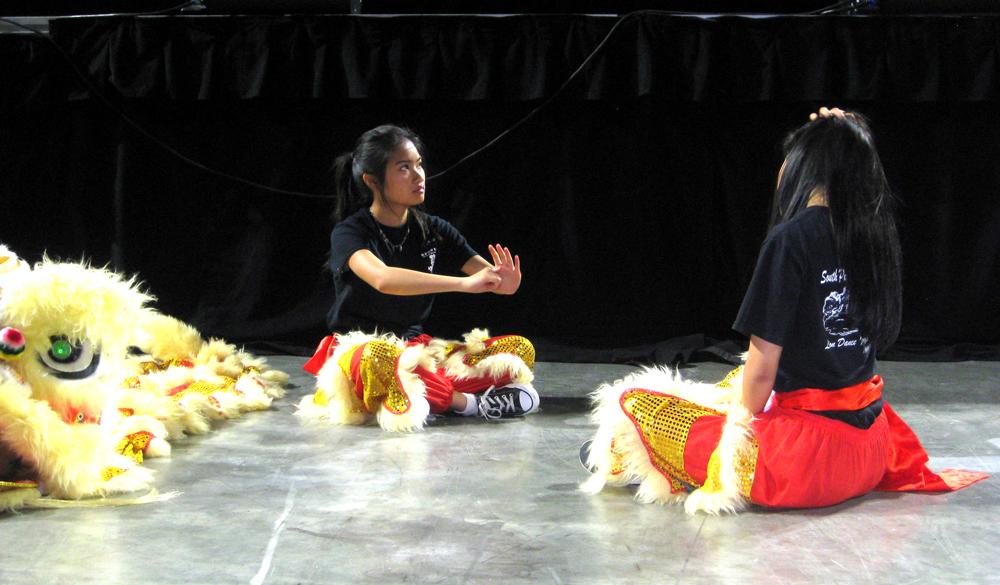 Marcella Hank Huang (left) warming up while Jaemie Lum watches. (Photo by Arlene Kiyomi Dennistoun/NWAW)