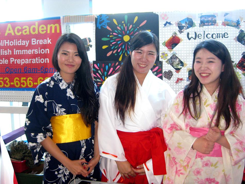 From left: Akami Murakami, Chiaki Mitsushima, and Kanna Yamagishi. International students from Highline College demonstrated Japanese hospitality and culture through traditional clothing (kimonos), games, and origami. (Photo by Arlene Kiyomi Dennistoun/NWAW)
