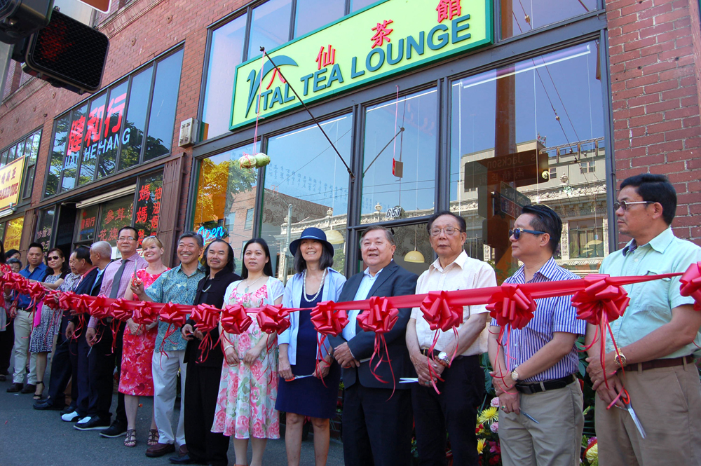 Community leaders, business owners, and politicians before the Vital Tea Lounge ribbon-cutting ceremony. (Photo by Rebecca Ip/SCP)
