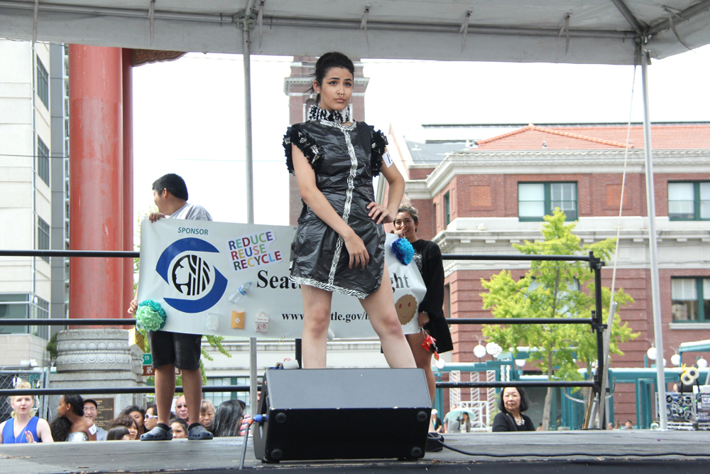 """2nd place winning design by Tony Oliver. """"Paper or Plastic"""" dress. (Photo by Eugene Tagawa)"""