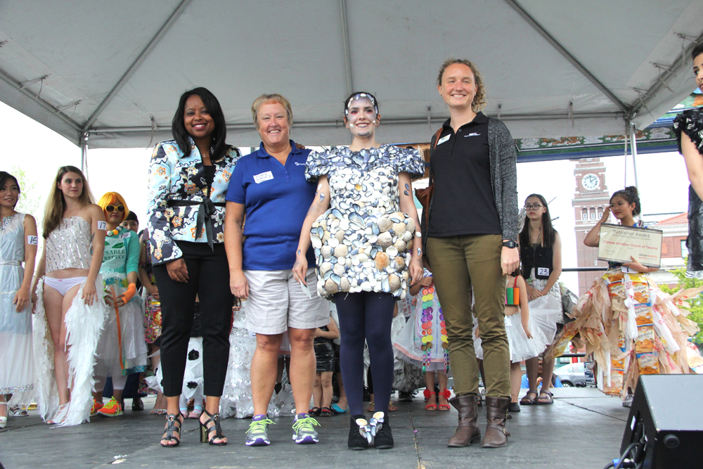 The judges. From left: Shaunta Hyde, Alaska Airlines; Mary Dorsey, Seattle City Light; Rebecca Bartenetti's design, worn by her model, first place winner; and Hannah Scholes, Waste Management. (Photo by Eugene Tagawa)