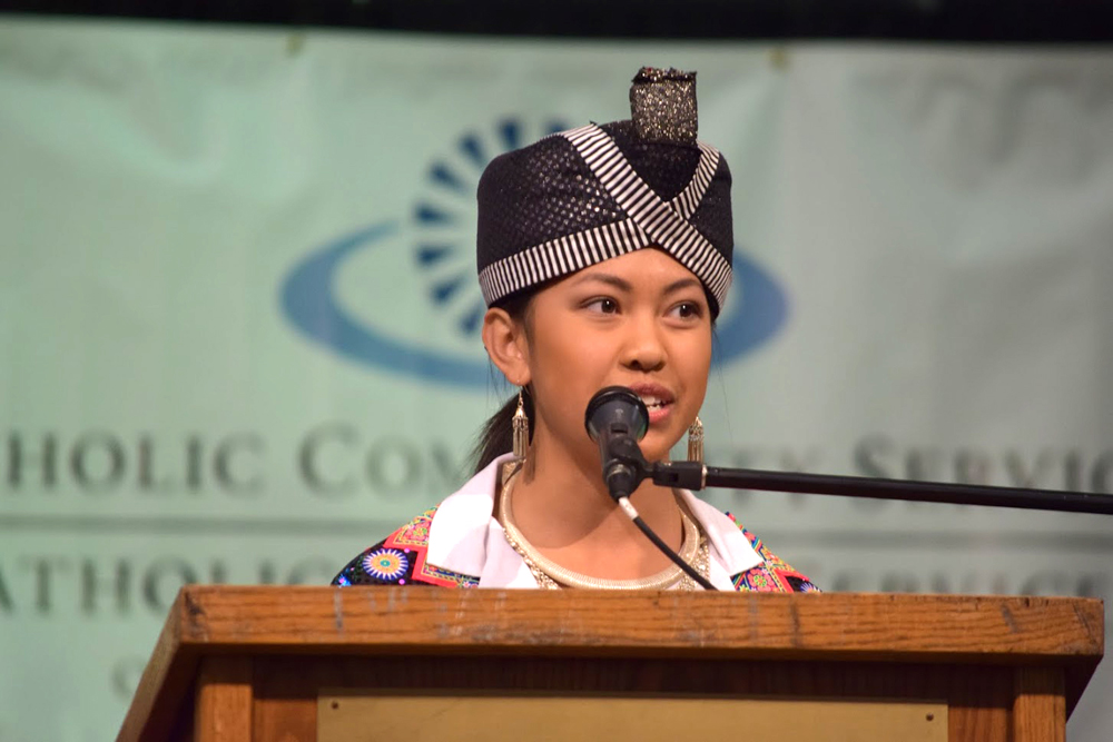 15-year old Tia Moua, Spokane Hmong Association, dressed in her native clothing, urged the audience to get out and vote. (Photo by Arlene Dennistoun/NWAW)