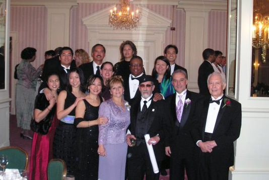 Bob Santos (right), Roberto Maestas, (3rd from right), Larry Gossett (second row, middle) and friends in Washington, D.C. in 2005, to receive the Bridge Builders Award. (Photo provided by Elaine Ko)