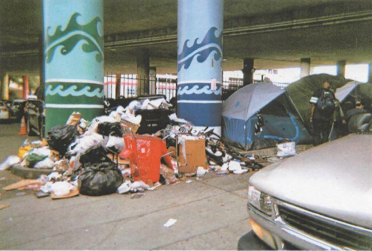 Pile of trash under the I-5 freeway on Jackson Street. (Photo credit: Patty Fong)