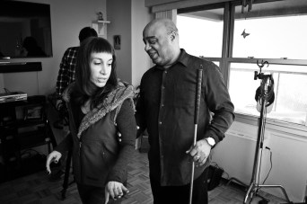 Frank gives Ilana a tour of his home