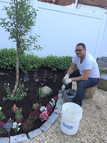 James in his happy place--gardening in his friend's Astoria backyard.