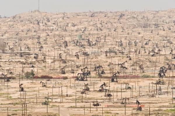 Desolate landscape of working oil pumps on the Kern River Oil Field