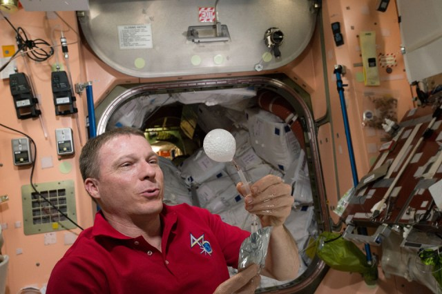 NASA's Terry Virts plays with a water bubble on the ISS in a 4K video
