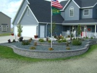 Retaining Wall Landscaping Around Flag Pole | Oasis ...