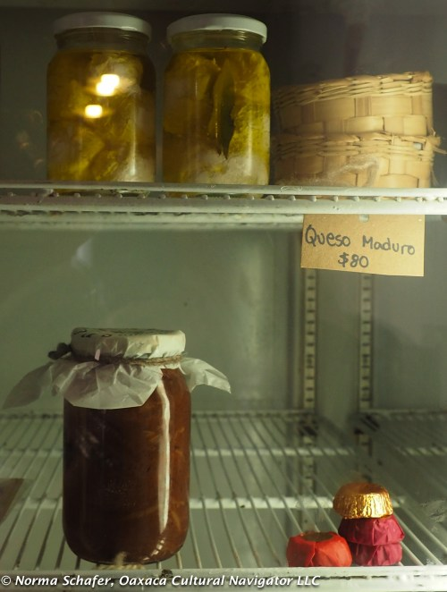 Top shelf, my favorite: kefir cheese in olive oil, bay leaf, whole black pepper