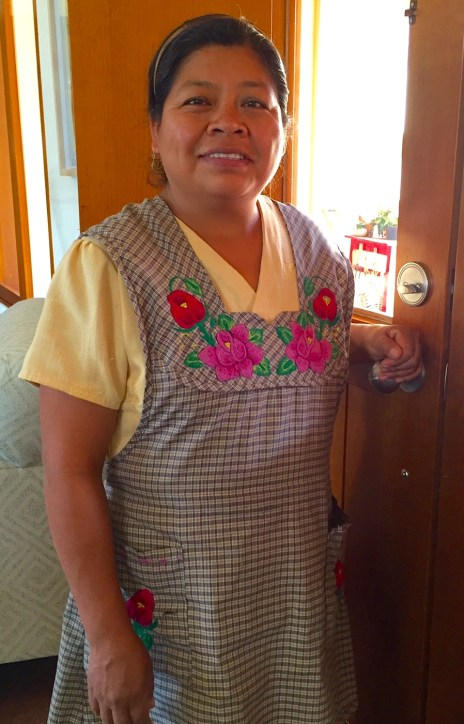 Rosario wears her apron with hand embroidered bodice