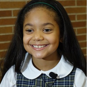 ALLISON REYES, A THIRD-GRADER AT OUR LADY OF THE ANGELS SCHOOL IN THE EAST HARLEM NEIGHBORHOOD OF NEW YORK, SMILES DURING AN AUG. 20 NEWS CONFERENCE TO OUTLINE DETAILS OF POPE FRANCIS' VISIT TO THE SCHOOL IN SEPTEMBER. / PHOTO: (CNS PHOTO/CHRIS SHGERIDAN, CATHOLIC NEW YORK)
