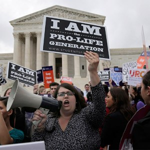 A pro-life supporter yells in a megaphone in front of the U.S. Supreme Court June 23. Pro-lifers and those on the other side of the abortion issue gathered in front of the court in anticipation of a decision on a Texas abortion law. The court was expected to hand down a ruling in Whole Woman's Health v. Hellerstedt June 27. (CNS photo/Andrew Gombert, EPA)