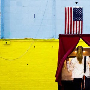 A WOMAN ENTERS A VOTING BOOTH IN HOBOKEN, N.J., JUNE 7. / PHOTO: (CNS PHOTO/JUSTIN LANE, EPA)