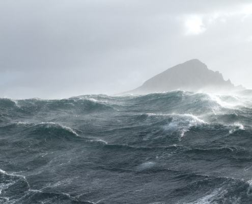 Cape Horn with strong wind and high seas