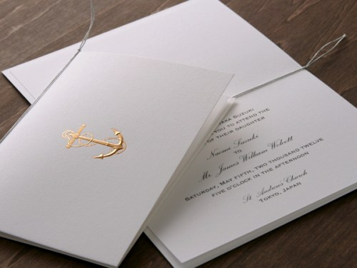gold nautical wedding invitation 500x375 Winged Wheel