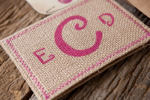 Burlap Pink Monogram Wedding Invitation Detail 500x333 Erin + Davids Rustic Pink + Burlap Wedding Invitations